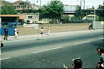 TQ3581 : Hugh Jones runs up Butcher Row, 1982 by Robin Webster