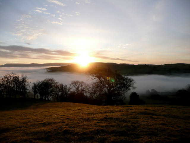View from field above Llywdallt across valley at sunrise