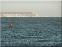 SZ1891 : Mudeford: red buoys and Isle of Wight view by Chris Downer