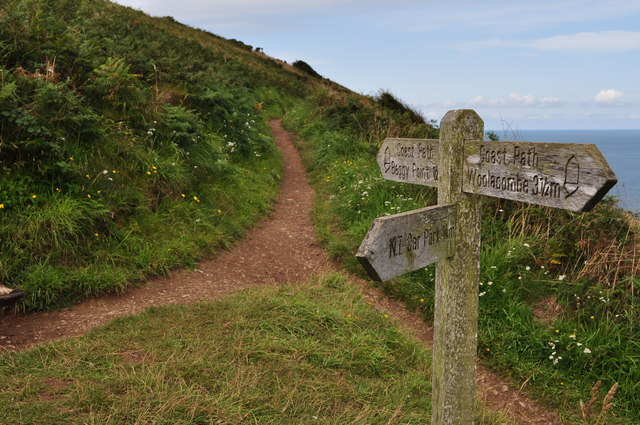 A sign post on the coast path to Baggy Point