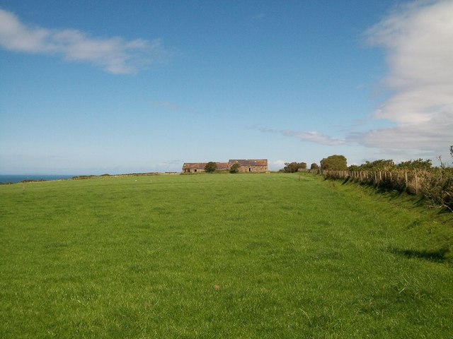 View across pastureland towards Pen-yr-orsedd