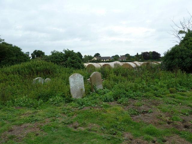 Hay bales behind the churchyard at Friston