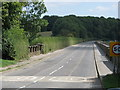 ST5661 : Road over the River Chew and the dam by Chew Stoke by Sarah Charlesworth