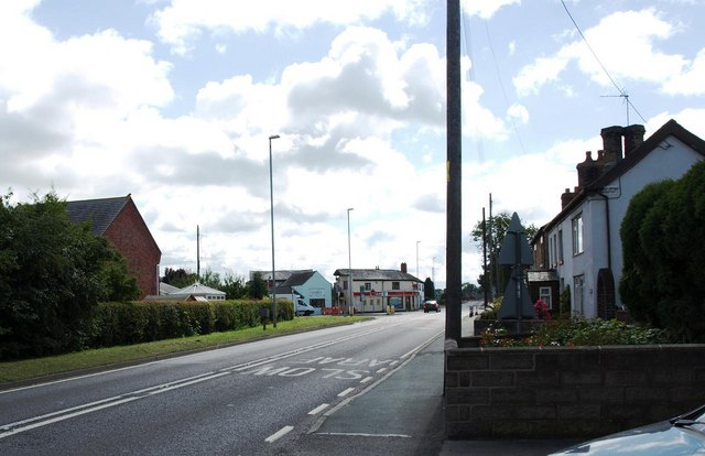 A483 in Four Crosses, looking towards the junction with the B4393