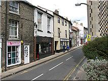 TL8683 : Whitehart Street past St Peter's church by Evelyn Simak