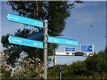 SJ7993 : Canal and motorway signs by Derek Harper