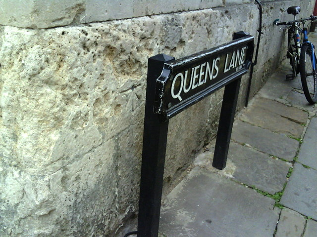 Benchmark on Queens College, behind street sign