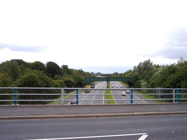 The M57 is crossed by the Liverpool Manchester railway