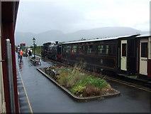 SH5752 : Train at Rhyd Ddu Station in the rain by Richard Hoare