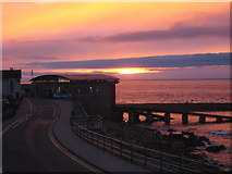 SW3526 : Sunset behind the lifeboat station. by Rod Allday