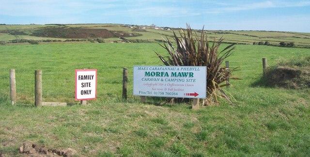 Signs at the entrance to Morfa Mawr Caravan Park