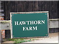 TM4266 : Hawthorn Farm Sign by Adrian Cable
