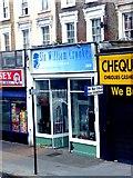 TQ3084 : Sir William Crookes charity shop, Caledonian Road, North London by Jim Osley