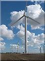 TQ9721 : Wind Turbines and the Little Cheyne Court Farm by David Anstiss