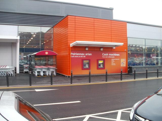 Bright orange cashpoints, Sainsbury's, Crindau