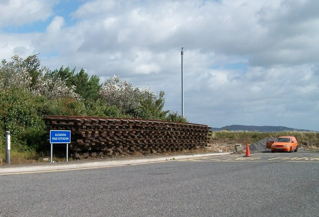 Dismantled sections of the dock railway lines stockpiled on the Alexandra Road Extension