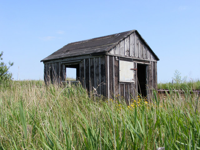 Disused permanent way hut beside the railway