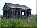 TM4599 : Derelict permanent way hut by Glen Denny