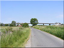 TM4598 : The road from Haddiscoe station by Glen Denny