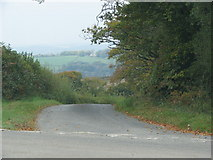 SS7218 : Road drops to Romansleigh from Beacon Cross by Sarah Charlesworth