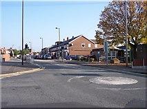 SD5408 : Mini roundabout and shops at Shevington by Raymond Knapman