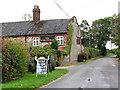 TG1439 : The Street past the Wheatsheaf public house, West Beckham by Evelyn Simak