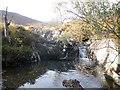 NM9575 : North Garvan River by John Ferguson