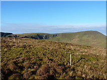 SH8414 : Old fenceposts on the summit of Foel Dinas by Richard Law