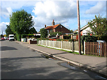 TG3311 : Bungalows in Mill Road, Blofield Heath by Evelyn Simak