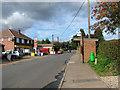 TG3211 : Woodbastwick Road through Blofield Heath by Evelyn Simak