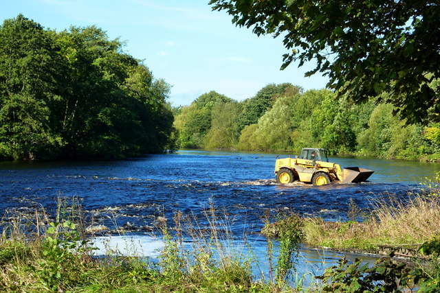 Farm vehicle crossing the Ford on the River Tees