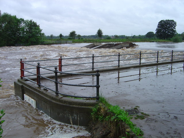 Broken Scar dam in flood