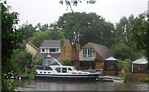 TQ1673 : Boat in front of riverside houses, Eel Pie Island by N Chadwick