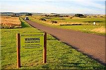 NU0545 : Approaching Goswick Golf Club by Mick Garratt