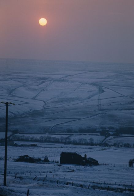 Sun over Hoyle Dean in snow