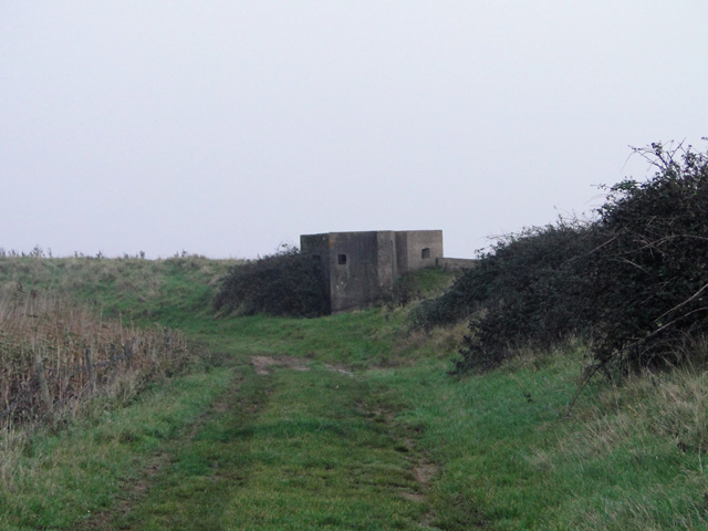 FW3/22 type pillbox set into the sea wall at Hollesley Bay