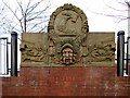 NZ2263 : Neptune and Armstrong coat of arms, Newcastle Business Park by Andrew Curtis