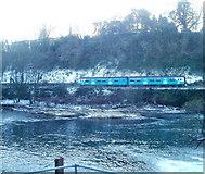 ST1380 : Railway train viewed across the River Taff, Radyr, Cardiff by Jaggery