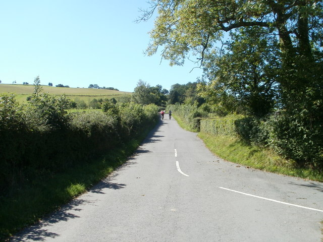 Cyclists head west from crossroads near Tredunnock