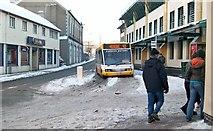 SH4862 : A snowy Caernarfon bus station by Eric Jones