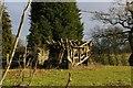 SJ6642 : Old threshing machine, Wood Orchard Lane, Audlem by Christopher Hilton