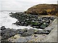 NZ4249 : Rock armour sea defence at southern end of Seaham promenade by peter robinson