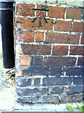 SY6778 : Benchmark on building at junction of Helen Lane and Maiden Street by Roger Templeman