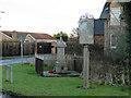 TF3613 : Sutton St Edmund Village sign and War Memorial by Adrian S Pye