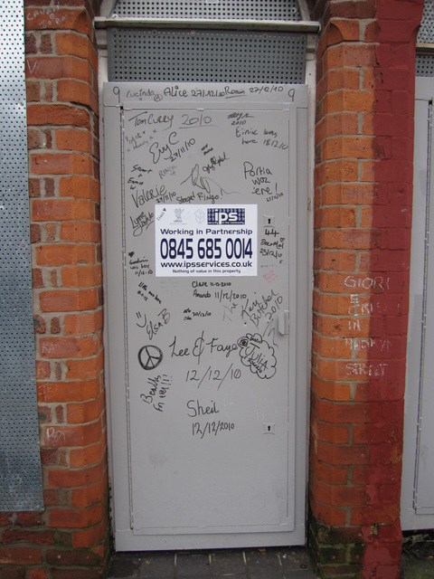 The security door and graffiti at #9 Madryn Street, Toxteth