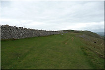 SH7683 : Path alongside enclosure wall, Great Orme by Phil Champion