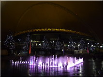 TQ1985 : Wembley: fountain, trees and stadium by night by Chris Downer
