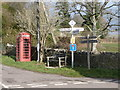 SY5898 : Chilfrome: telephone box and signposts by Chris Downer