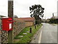 TG0536 : GR postbox in the Street Thornage by Adrian S Pye