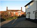 TM0588 : Cottages at Hunt's Corner by Evelyn Simak